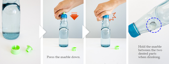 Press the marble down. Hold the marble between the two dented parts when drinking